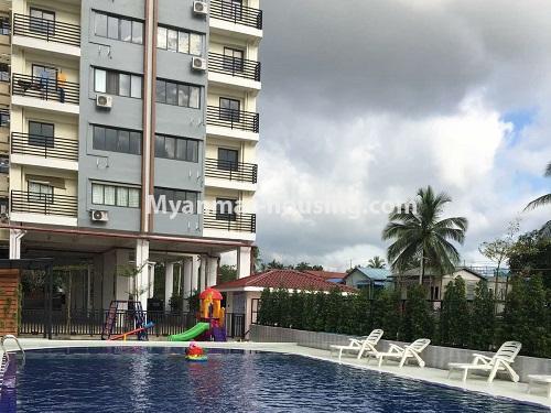 မြန်မာအိမ်ခြံမြေ - ငှားရန် property - No.4621 - အင်းစိန်တွင် အိပ်ခန်းနှစ်ခန်းပါသော ရိုင်ရယ်သီရီကွန်ဒိုခန်း ငှားရန်ရှိသည်။swimming pool and building view